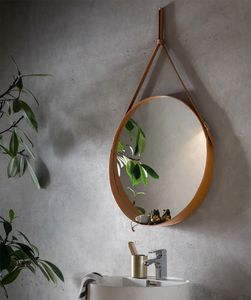 Corium, Espejo redondo de cuero