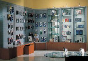 Overglass comp.02, Mobiliario de tienda, con paneles de chapa perforada y banco.