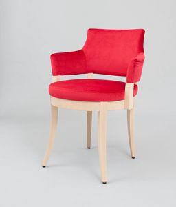 C42, Sillón acolchado con asiento redondo.