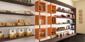 Revolution - estantes para panaderías y cafeterías, Pared de exposición con cubos giratorios